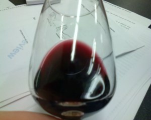 The best way to evaluate color is to tilt your glass and hold the wine over white piece of paper, or in this case a long-overdue peer review.