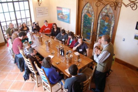A bunch of respectable wine bloggers and some dude in a Cornell jersey listen to winemaker Roman Roth in the palatial tasting room at Wölffer Estates, in the Hamptons, Long Island (photo credit: Lenn Thompson)