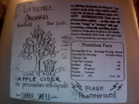 """small text on upper right:  At Littletree Orchards, we bring you 7 generations worth of the cidermaker's skill to make this all-natural, unfiltered apple cider. KEEP REFRIGERATED! There are no preservatives added... so this cider will become """"tangy"""" or """"snappy"""" with age, producing a naturally sparkling drink!"""